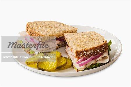 Turkey Sandwich on Wheat Bread; Halved with Pickles