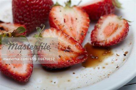 Halved Fresh Strawberries Tossed with Balsamic Vinegar and Cracked Black Pepper
