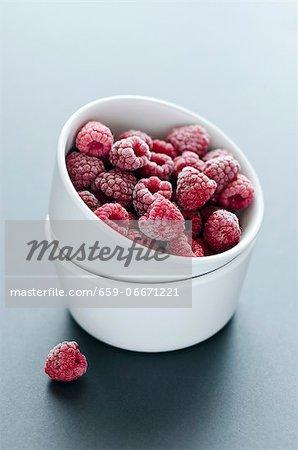 A ramekin of frozen raspberries