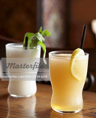 Spanish ìSlushitoî Drinks;White One is Coconut Rum Lemongrass Lime; Orange One is Grapefruit Bourbon Chamomile