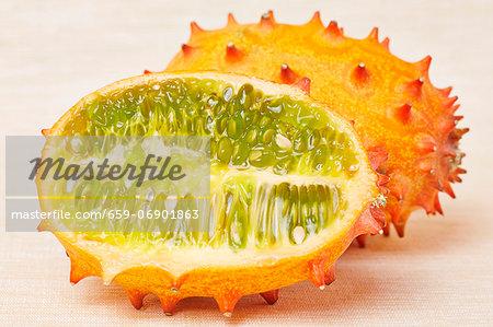 A horned melon cut lengthways (cucumis metuliferus)