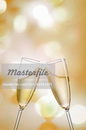 Clinking champagne glasses