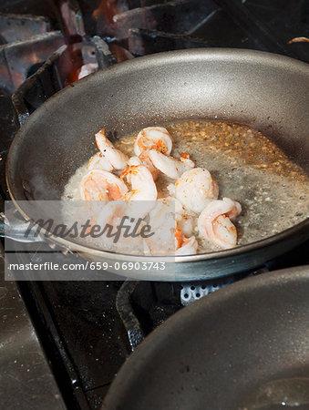 Prawns being fried in a pan