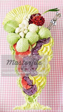 An ice cream sundae made from vegetables, fruit and lettuce