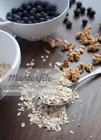 Muesli ingredients: porridge oats, walnuts and blueberries