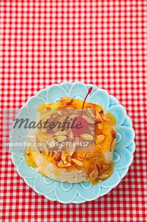 Semifreddo with almonds, honey and a glacÈ cherry
