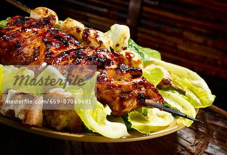Grilled teriyaki chicken on Caesar salad