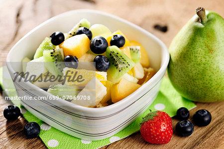 Healthy fresh fruit salad, selective focus