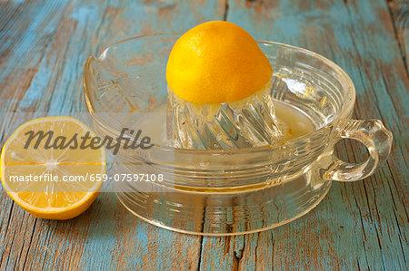 Half of a Meyer Lemon Juiced on a Glass Juicer