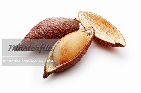 Salak fruit, one partly peeled