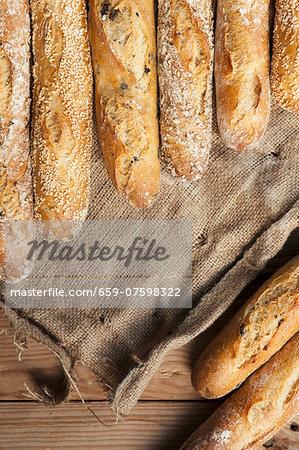 Several baguettes lying on jute