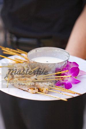 A Platter of Shrimp Skewers with a Yogurt Dip