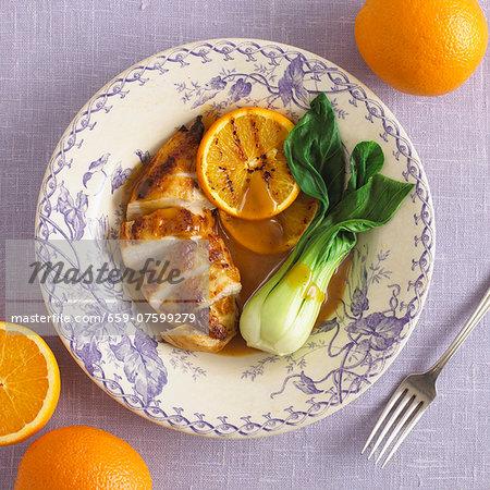 Chicken breast with orange sauce and pak choi