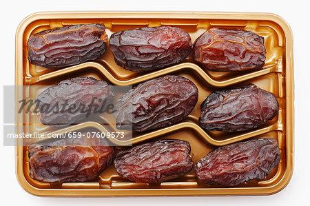Dried Medjool dates in plastic packaging