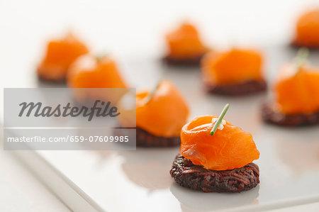 Smoked salmon on beetroot potato cakes