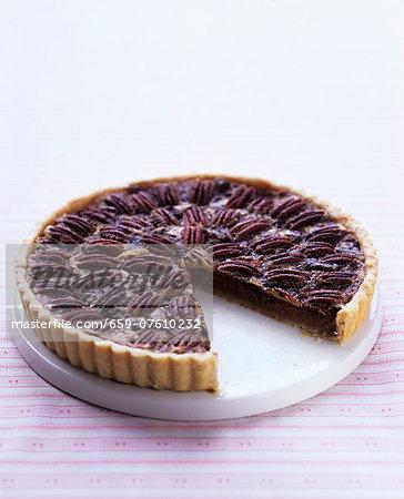 Chocolate and pecan nut tart, sliced