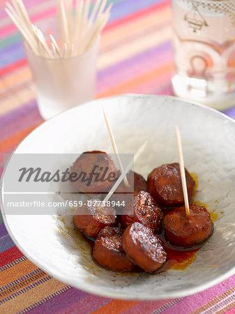 Grilled chorizo slices on sticks