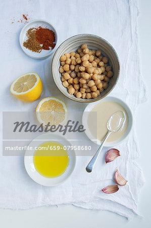 Ingredients for hummus: chickpeas, tahini, garlic, lemon, olive oil, paprika and cumin