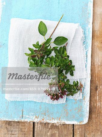 Fresh oregano on a blue wooden board