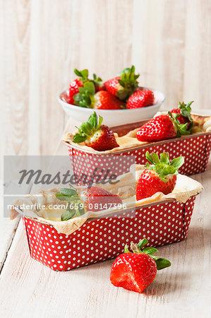 Mini strawberry and quark ckaes in polka dot baking tins