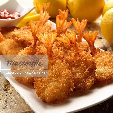 Breaded fried prawns with lemons