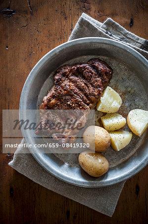 Grilled ribeye steak with potatoes