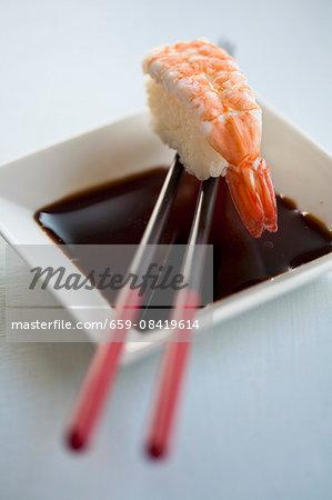 Soy sauce with a prawn nigiri sushi