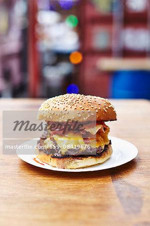 A double cheeseburger with bacon