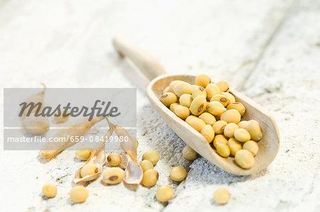 Soya beans in wooden scoop