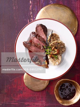 Fillet of venison with a blueberry sauce and chanterelle mushroom dumplings