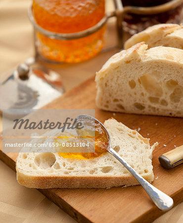 Marmalade spread on a slice of homemade bread