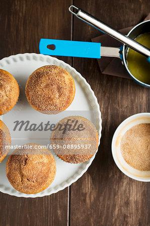 Nutella doughnut muffins dusted with cinnamon sugar