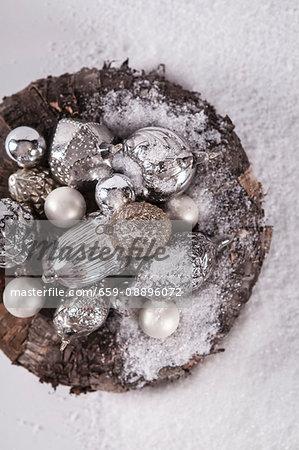 A bowl of antique silver baubles