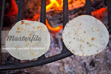 Tortillas on a fire grate