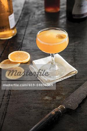 A champagne cocktail with orange garnish