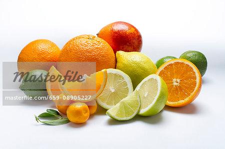 An arrangement of citrus fruits on a white surface