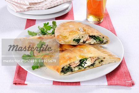 Mezzaluna con spinaci (Italian pastry pockets with a spinach filling)
