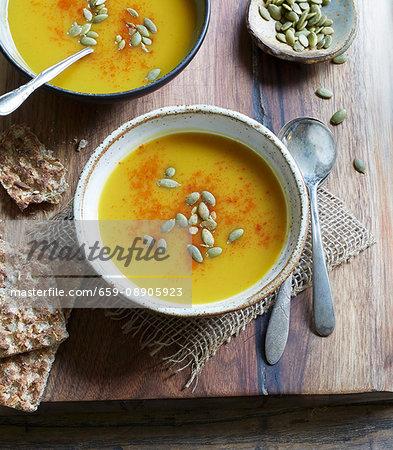 Butternut squash soup with pumpkin seeds and crispbread