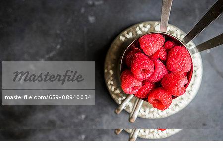 Fresh raspberries in silver cups