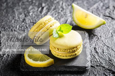 Lemon macaroons on a black stone