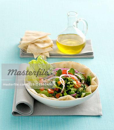 A mixed salad served on unleavened Arabian bread