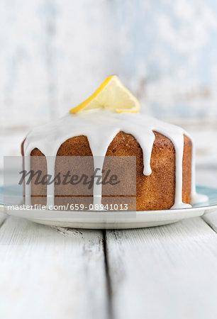 Vegan lemon cake with white icing