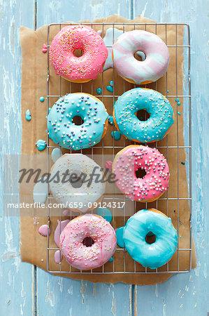 Doughnuts with a colorful sugar glaze and sugar balls