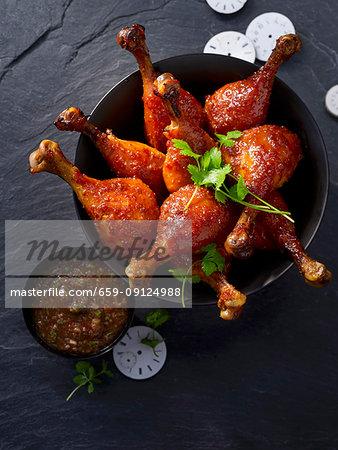 Glazed corn fed chicken drumsticks with a tamarind dip