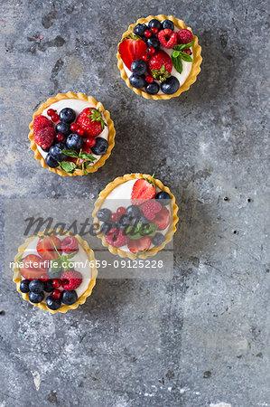 Mixed berry tarts with vanilla cream