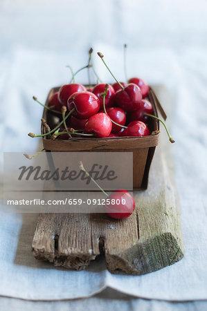 Cherries in a wooden basket