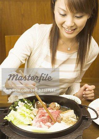Woman Eating Sukiyaki