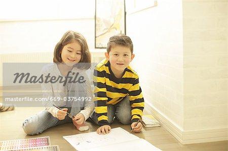Children writing graffiti