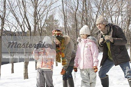 Family peering through binoculars