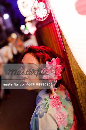 Young woman in Yukata at Matsuri at night
